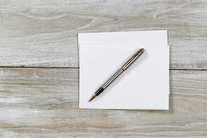 Wooden Desktop with envelope and pen