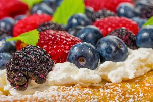Berry tart with whipped cream