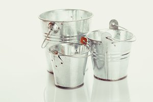 Three metal buckets