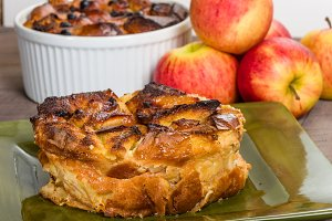 Apple bread pudding on green plate