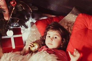 Little girl near a Christmas tree