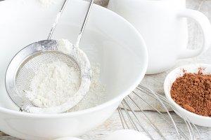flour,milk,eggs on a white