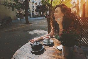 Curly brunette girl in cafe