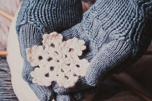 Hands in knitted gloves