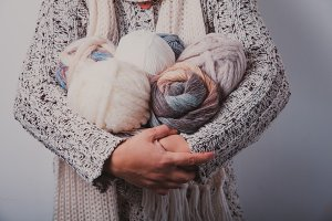 Woman with basket of balls woolen yarn