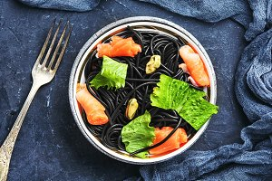 black pasta with mussels and trout