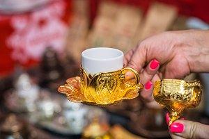 hand holding Turkish coffee cup