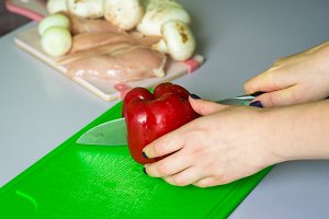 hand cut bell pepper on the Board