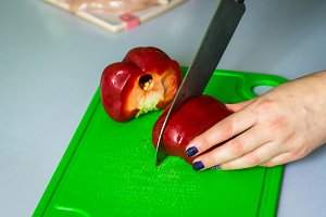 hand cut the bell pepper on board