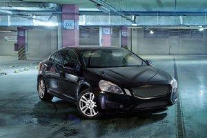 Luxury black car parked underground
