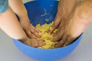Children and dad hands preparing shortbread dough