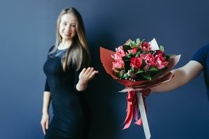 Bouquet of red tulips as boyfriend's gift for cute girl.