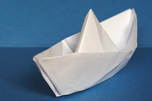 paper boat over blue