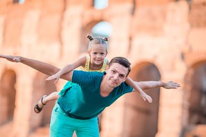 Family in Europe. Happy father and little adorable girl enjoy vacation among Colloseum