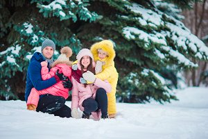 Happy family enjoy winter snowy day