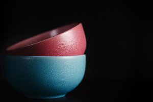 red and blue bowl on a black table