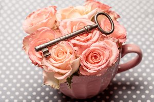 Old key and roses