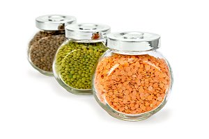 Lentils and pea flakes in jar isolat