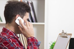 man talking on the phone at home in the office