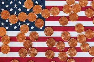 Dollar coins and flag of the United States