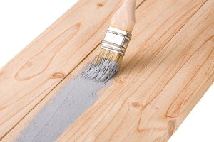 painting wooden board paint brush gray color isolated on white background