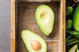 Avocado in wooden tray