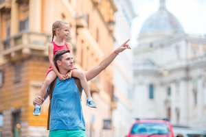 Family in Europe. Happy father and little adorable girl in Rome during summer italian vacation
