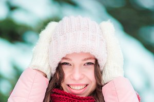 Portrait of young woman outdoors on beautiful winter snow day