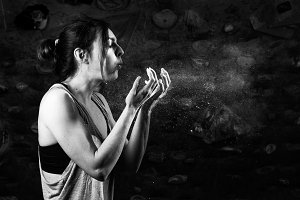 Young woman blowing magnesium