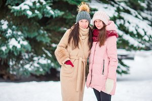 Young girlfriends outdoors on beautiful winter snow day