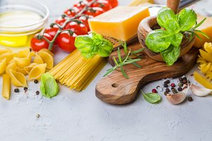 Raw pasta ingredients background