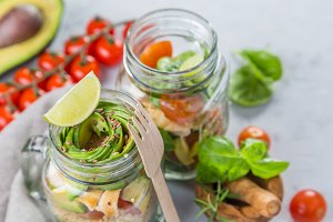Fresh healthy salad in glass jar and ingredients
