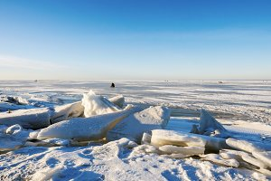 Fishermen on the ice of the Gulf of Finland, Saint Petersburg, Russia