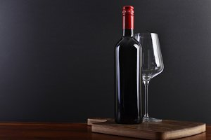 Red wine on board with glass