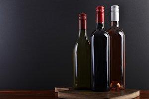 Three bottles on a board