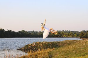 Levitation beautiful woman at lake