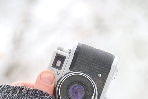 Travel, trip, journey, vacation concept. Traveler holding retro camera.
