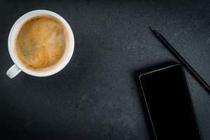 Smartphone and a cup of coffee