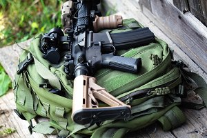 The Black Rifle and green backpack, shallow depth of field