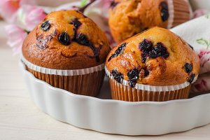 Blueberry muffins on wooden vintage background. Selective focus