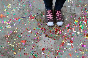 Slippers and confetti in floor