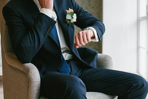 The groom sits in a Chair