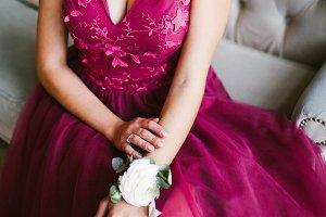A girl in a Burgundy dress