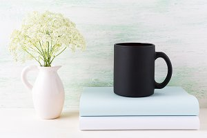 Black coffee mug mockup with books