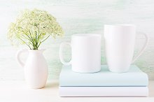 Two white mugs mockup with books