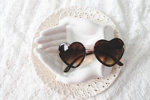 Sunglasses On White Dishes