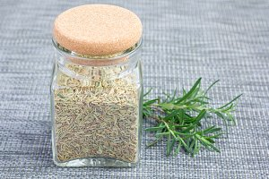 Herbal rosemary tea in a glass jar on oriental background, horizontal, copy space