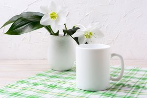 White mug mockup with lily in vase