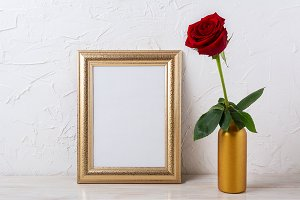 Gold frame mockup with dark red rose