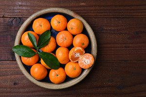 Mandarin Oranges in Bowl on Wood